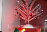 An Aluminum Christmas Tree Illuminated A Revolving Color Wheel regarding sizing 768 X 1024